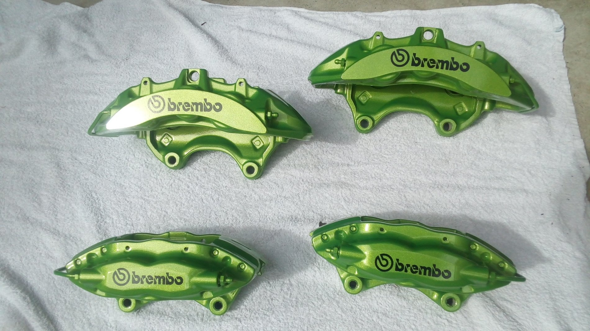 Green Brembo 6 and 4 pot calipers.jpg